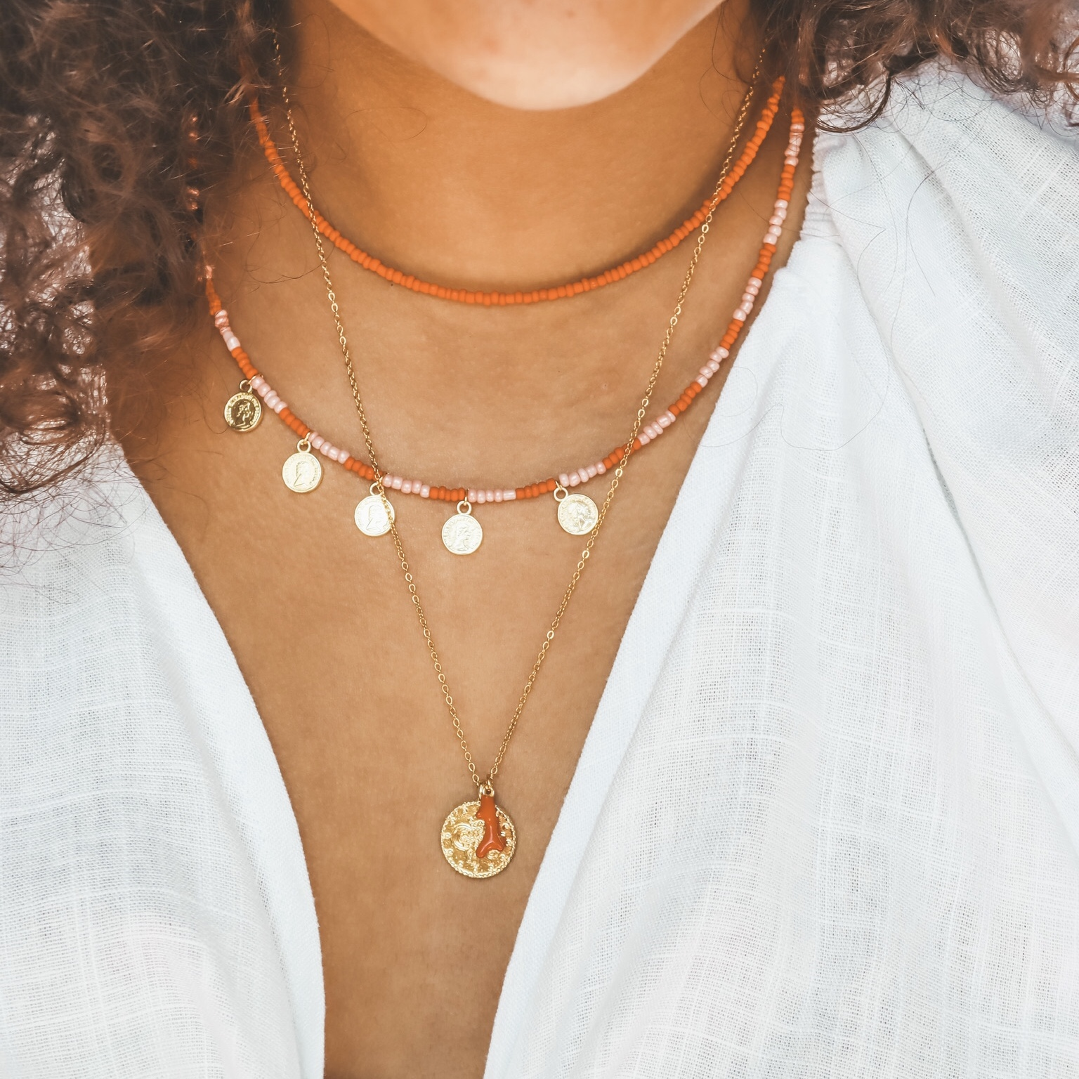 Fine jewelry: coin coral necklace