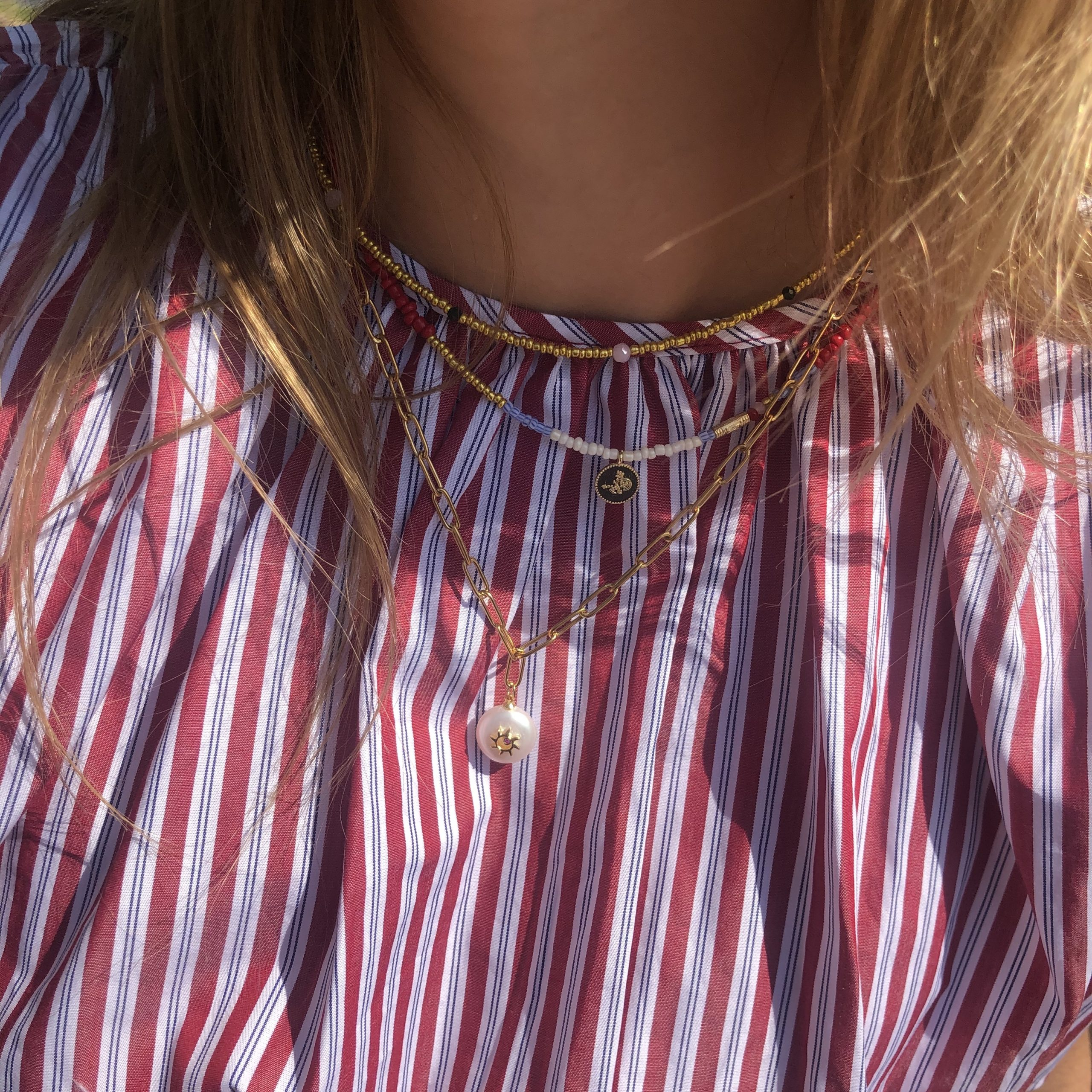 Fine jewelry: gold chain sun pearl